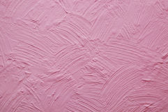 Pink wall with plaster relief Stock Photos
