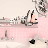 Pink wall and a shelf in the bathroom with hygiene accessories. Square Royalty Free Stock Photo