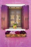 Pink wall and shutters on window, Burano, Italy. Pink wall, shutters and flowers on window, Burano, Italy,  near Venice Stock Photo