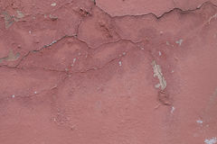 Pink wall texture with peeling paint. Stock Images
