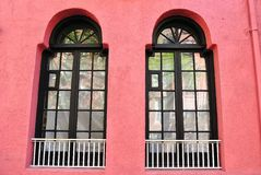 Pink Wall with Windows. A pink exterior walls with arched windows Royalty Free Stock Photo