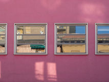 Pink wall. And windows with reflections Royalty Free Stock Image