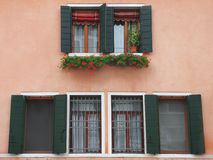 Pink wall with windows in Venice. Pink wall with building windows in Venice Stock Photography