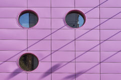 Pink wall. Wish round windows Royalty Free Stock Image