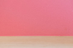 Pink wall and wooden floor Royalty Free Stock Images