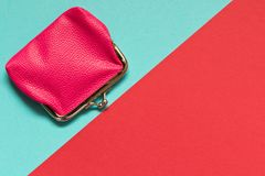 Pink wallet on blue red background . Saving concept stock photo