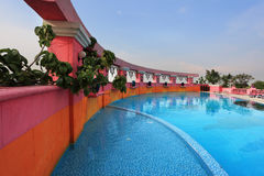 Pink walls and blue water. The luxurious pool Royalty Free Stock Image