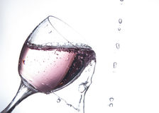 Pink water being poured into a wine glass Royalty Free Stock Photo
