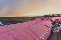 Pink water tube against the storm at Roskilde fjord. Pink water tube against the flood at Roskilde fjord, Frederikssund, Denmark, October 30, 2017 royalty free stock images