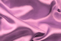 Pink wavy silk fabric Stock Photos