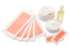 Pink waxing strips, cream and body oil Royalty Free Stock Photography