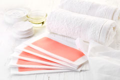 Pink waxing strips, cream and body oil Stock Photography