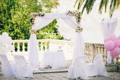 Pink wedding arch with flowers. Wedding isle and arch with weddings chairs and wedding flower decoration Stock Photography