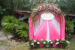 Pink wedding arch flowers in-park for a engage wedding Royalty Free Stock Image