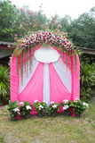 Pink wedding arch flowers in-park for a engage wedding Stock Images