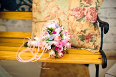 Pink wedding bouquet on a bench Royalty Free Stock Photo