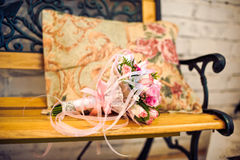 Pink wedding bouquet on a bench Royalty Free Stock Image