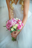 Pink wedding bouquet in the hands of the bride Royalty Free Stock Image