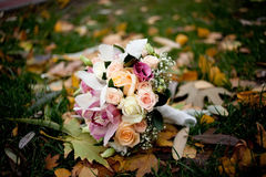 Pink wedding bouquet with roses and orchids. Colorful wedding bouquet with roses and orchids Stock Images