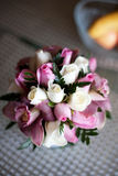 Pink wedding bouquet with roses and orchids. Colorful wedding bouquet with roses and orchids Royalty Free Stock Image