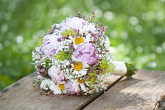 Pink wedding bouquet. Round, pink wedding bouquet of peonies and daisyes Stock Photo
