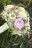 Pink wedding bouquet. Round, pink wedding bouquet of peonies and daisyes Stock Photography