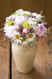 Pink wedding bouquet. Round, pink wedding bouquet of peonies and daisyes Royalty Free Stock Photography