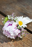 Pink wedding boutonniere. Round, pink wedding boutonniere of peonies Stock Image