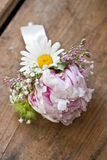 Pink wedding boutonniere. Round, pink wedding boutonniere of peonies Stock Images