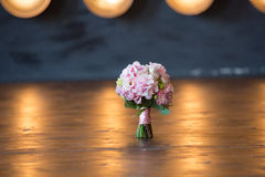 Pink wedding bridal bouquet. On fires of lamps Stock Photo