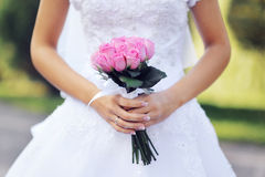 Pink wedding bridal bouquet of roses in hands of the bride Royalty Free Stock Image
