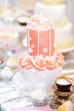 Pink wedding cake decorated with sugar flowers Royalty Free Stock Image