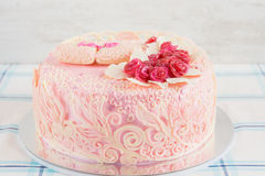 Pink wedding cake with flowers Stock Photos