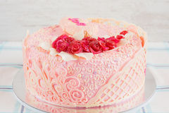 Pink wedding cake with flowers Stock Images