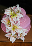 Pink Wedding Cake Lily flower topper Stock Photo
