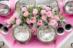 Pink wedding car. A bunch of pink roses at a retro car front Stock Photography