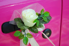 Pink wedding car door with flower decoration Royalty Free Stock Photo