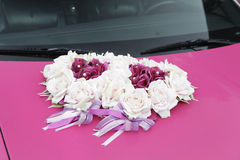 Pink wedding car. The hood of pink wedding car with flower arrangement Stock Image
