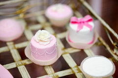 Pink wedding cupcakes. Delicious pink wedding cupcakes and cakes decorated with flowers Stock Photography