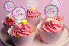 Pink wedding cupcakes with I Do topper signs - horizontal. Royalty Free Stock Photos