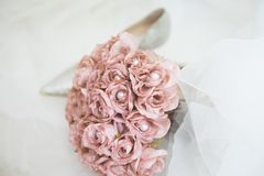 Pink wedding flowers and heels. Before ceremony bride  wearing this shoes Royalty Free Stock Images
