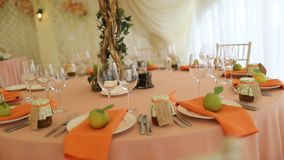 Pink wedding glasses with rhinestones is on the table. With a blue tablecloth stock footage