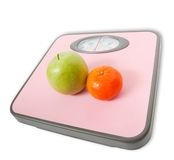 Pink Weighing Scales and fruits Stock Images