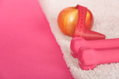 Pink weights on white towel Royalty Free Stock Image