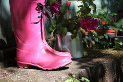 Pink wellingtons in the garden Stock Photography