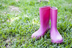 Pink wellingtons on grass Stock Photography