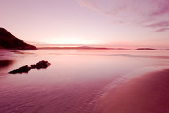 Pink and wet. Coldbackie beach just before dark (Scotland Royalty Free Stock Photo