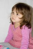 Pink on white 6. Little girl in pink against white background Royalty Free Stock Images