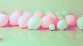 Pink and white balloon on the floor Stock Photo