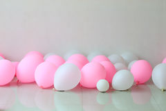 Pink and white balloon on the floor Royalty Free Stock Photo